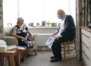 Britain's Prime Minister Boris Johnson, right talks to resident Kathleen, during a visit to Westport Care Home in Stepney Green, east London, Tuesday, Sept. 7, 2021, ahead of unveiling his long-awaited plan to fix the broken social care system. (Paul Edwards/Pool Photo via AP)