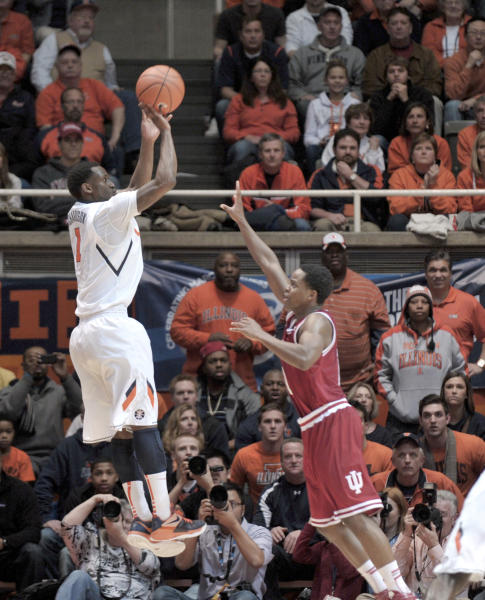 "Illinois' D.J. Richardson (1) goes up for a 3-point shot over Indiana's Kevin ""Yogi"" Ferrell during the second half of an NCAA college basketball game at Assembly Hall in Champaign, Ill., on Thursday, Feb. 7, 2013. Illinois defeated No. 1 Indiana 74-72. (AP Photo/John Dixon)"