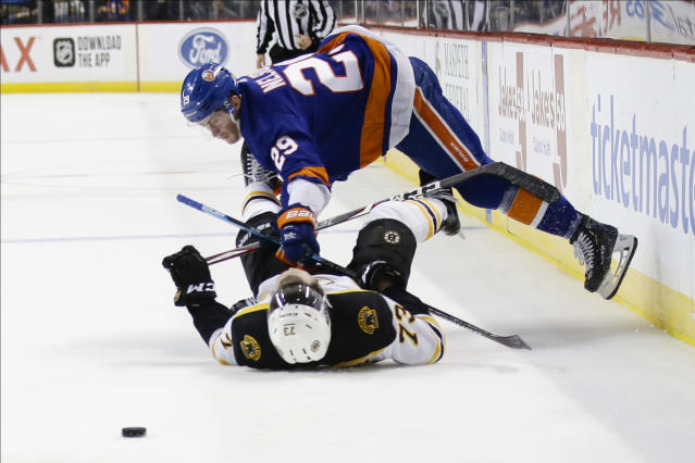 New York Islanders' Brock Nelson (29) checks Boston Bruins' Charlie McAvoy (73) during the second period of an NHL hockey game Saturday, Jan. 11, 2020, in New York. (AP Photo/Frank Franklin II)