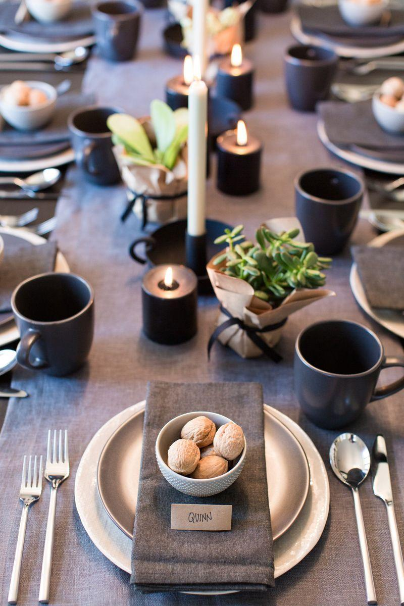 """<p>Black and gray look suddenly festive with lots of rustic touches, like <a href=""""https://www.goodhousekeeping.com/holidays/christmas-ideas/how-to/g1363/succulent-centerpiece/"""" rel=""""nofollow noopener"""" target=""""_blank"""" data-ylk=""""slk:wrapped succulents"""" class=""""link rapid-noclick-resp"""">wrapped succulents</a>, flickering candles, and bowls of walnuts. Keep it casual by swapping formal wine glasses for cozy coffee mugs.</p><p><strong><a class=""""link rapid-noclick-resp"""" href=""""https://www.amazon.com/Shop-Succulents-Unique-Succulent-Collection/dp/B018WLMXG2?tag=syn-yahoo-20&ascsubtag=%5Bartid%7C10055.g.2196%5Bsrc%7Cyahoo-us"""" rel=""""nofollow noopener"""" target=""""_blank"""" data-ylk=""""slk:SHOP SUCCULENTS"""">SHOP SUCCULENTS</a></strong></p>"""