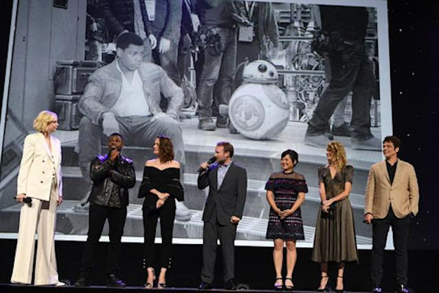<p>Finn and BB-8 apparently aren't seeing eye to eye. (Photo: Disney/LA Image Group) </p>