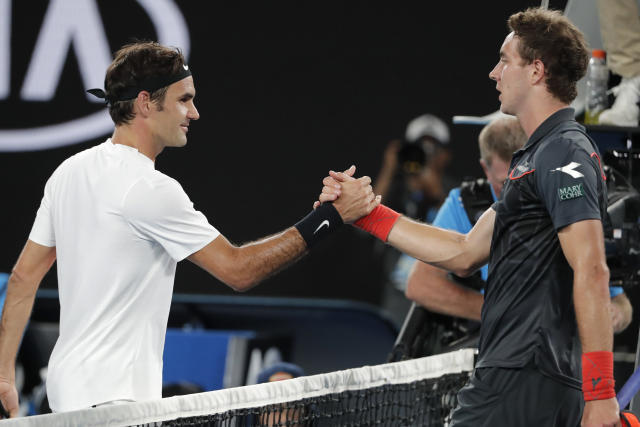 Switzerland's Roger Federer, left, is congratulated by Germany's Jan-Lennard Struff after winning their their second round match at the Australian Open tennis championships in Melbourne, Australia, Thursday, Jan. 18, 2018. (AP Photo/Vincent Thian)