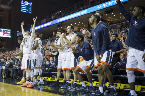 The Virginia Cavaliers bench celebrates during Virginia's game against the North Carolina Tar Heels at John Paul Jones Arena on February 27, 2017 in Charlottesville, Virginia.
