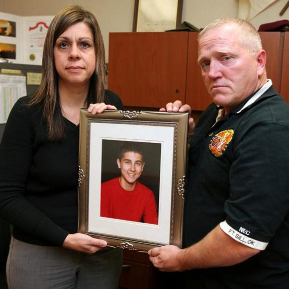 Michelle and David Rauls hold a photograph of their son Nicholas, 13, on Dec. 1 at Knox Hall. Nick committed suicide Feb. 7, 2010, at the family's Elgin home.