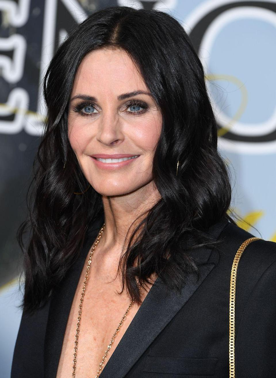 """<p>The <em>Cougar Town</em> star works out with celeb trainer Michelle Lovitt, who also trains Julianne Moore and Julia Luis-Dreyfus. <a href=""""https://www.self.com/story/lifting-with-barbells-for-the-first-time"""" rel=""""nofollow noopener"""" target=""""_blank"""" data-ylk=""""slk:According to Lovitt"""" class=""""link rapid-noclick-resp"""">According to Lovitt</a>, Cox's workouts include <a href=""""https://www.prevention.com/fitness/fitness-tips/a26765994/benefits-of-lifting-weights/"""" rel=""""nofollow noopener"""" target=""""_blank"""" data-ylk=""""slk:strength training"""" class=""""link rapid-noclick-resp"""">strength training </a>with barbells and plenty of high-intensity supersets.</p>"""