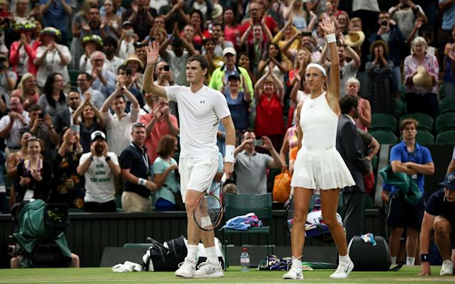 Jamie Murray and Victoria Azarenka wave to the crowd after their latest win - PA