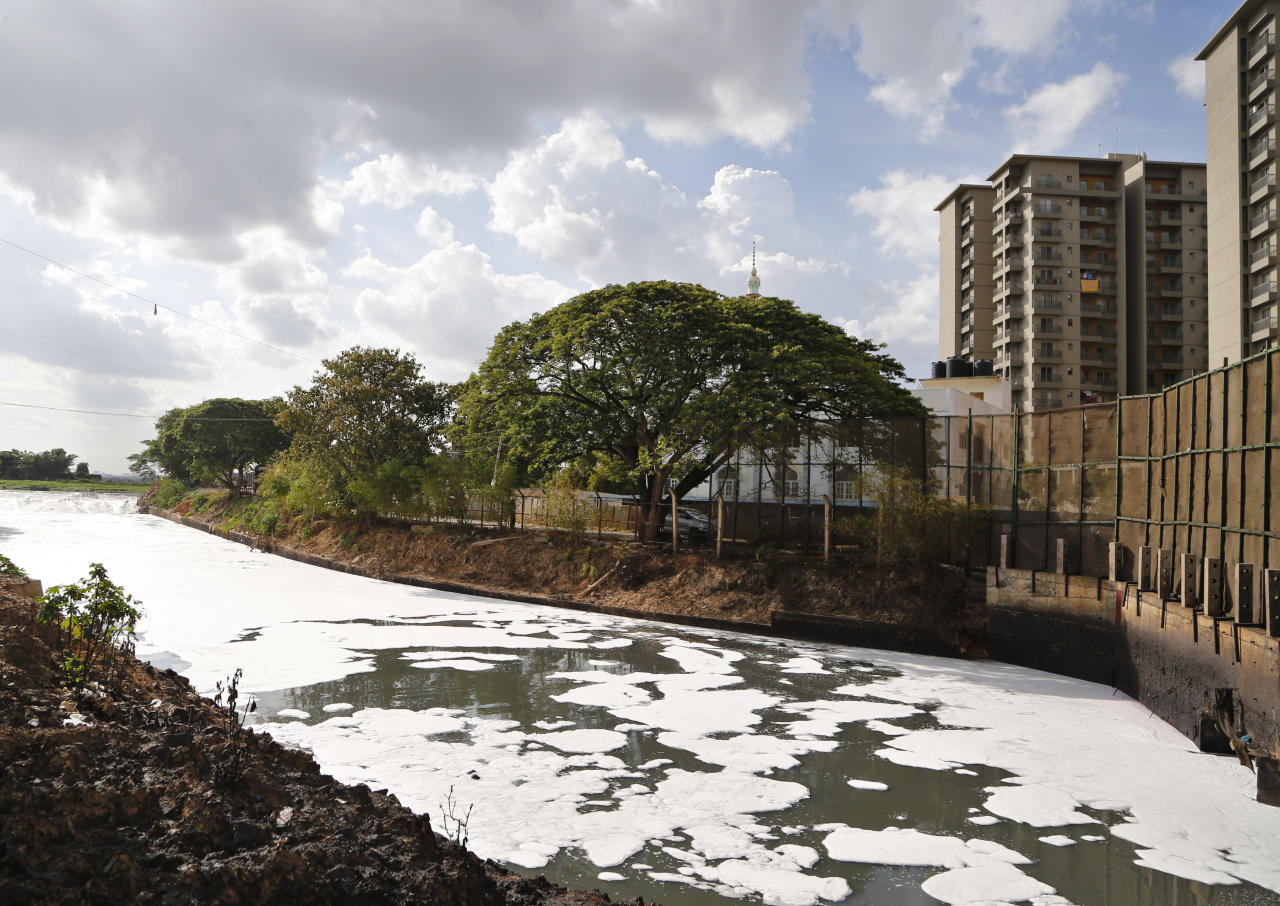 <p> FILE - In this June 5, 2017, file photo, toxic froth from industrial pollution floats on Bellundur Lake on World Environment Day, in Bangalore, India. Environmental pollution - from filthy air to contaminated water - is killing more people every year than all war and violence in the world. (AP Photo/Aijaz Rahi, File) </p>