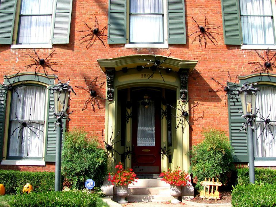 <p>Keep arachnophobes at bay by attaching giant furry spiders to your home's facade. </p>