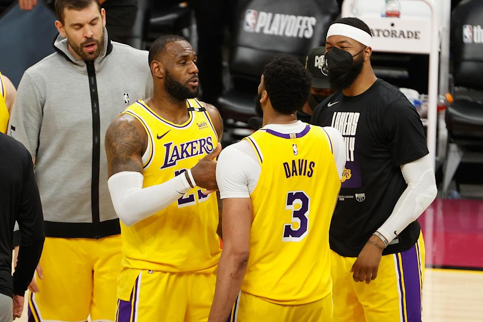 PHOENIX, ARIZONA - MAY 25: LeBron James #23 of the Los Angeles Lakers celebrates with Anthony Davis #3 after defeating the Phoenix Suns in  Game Two of the Western Conference first-round playoff series at Phoenix Suns Arena on May 25, 2021 in Phoenix, Arizona. The Lakers defeated the Suns 109-102.  NOTE TO USER: User expressly acknowledges and agrees that, by downloading and or using this photograph, User is consenting to the terms and conditions of the Getty Images License Agreement.  (Photo by Christian Petersen/Getty Images)