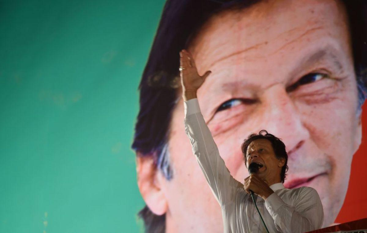 Pakistani cricket star-turned-politician and head of the Pakistan Tehreek-e-Insaf (PTI) Imran Khan gestures as he delivers a speech during a political campaign rally, in Islamabad, on July 21, 2018, ahead of the general election. - Pakistan will hold the general election on July 25, 2018. (Photo by WAKIL KOHSAR / AFP) (Photo credit should read WAKIL KOHSAR/AFP/Getty Images)