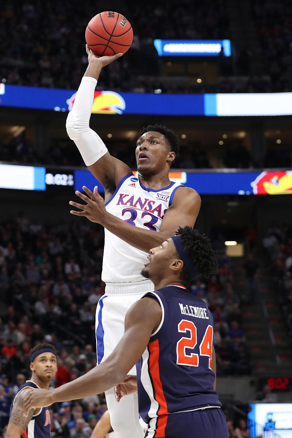<p>David McCormack #33 of the Kansas Jayhawks goes up for a shot against Anfernee McLemore #24 of the Auburn Tigers during their game in the Second Round of the NCAA Basketball Tournament at Vivint Smart Home Arena on March 23, 2019 in Salt Lake City, Utah. (Photo by Patrick Smith/Getty Images) </p>