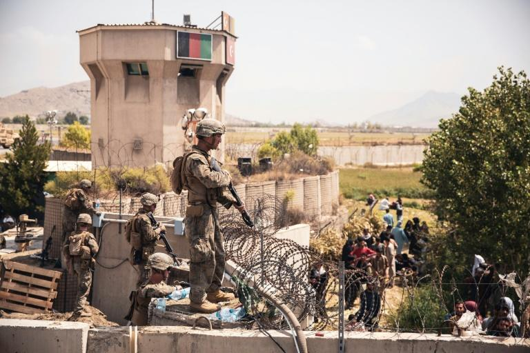 US Marines assist with security at an Evacuation Control Checkpoint at Hamid Karzai International Airport in Kabul on August 20, 2021, as the United States scrambles to get its citizens out of the country