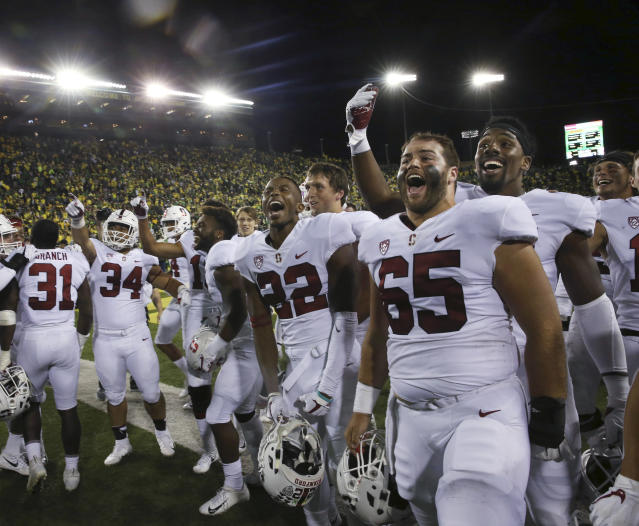 Stanford players celebrate near fans at Autzen Stadium after defeating Oregon 38-31 in overtime in an NCAA college football game Saturday, Sept. 22, 2018, in Eugene, Ore. (AP Photo/Chris Pietsch)