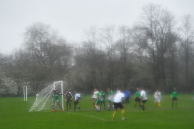 The ball hits the back of the net as Sunday League football continues on Clapham Common