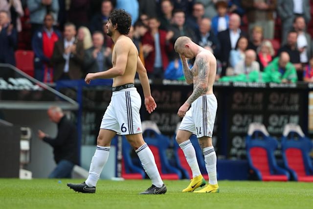 "Soccer Football - Premier League - Crystal Palace vs West Bromwich Albion - Selhurst Park, London, Britain - May 13, 2018 West Bromwich Albion's Ahmed Hegazi and James McClean look dejected after the match REUTERS/Hannah McKay EDITORIAL USE ONLY. No use with unauthorized audio, video, data, fixture lists, club/league logos or ""live"" services. Online in-match use limited to 75 images, no video emulation. No use in betting, games or single club/league/player publications. Please contact your account representative for further details."