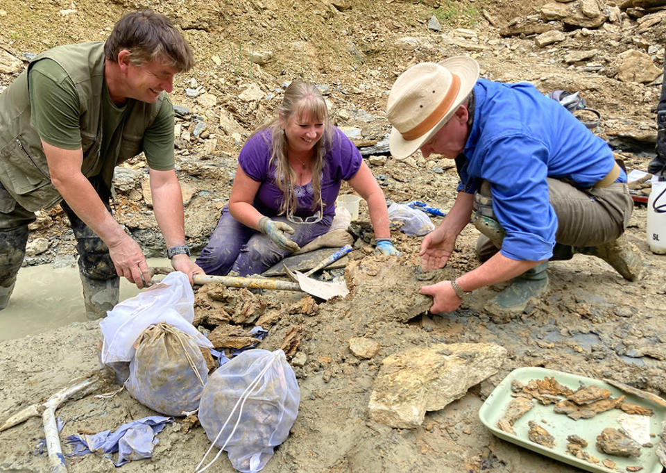 Neville, Sally and Mark work to free fossils