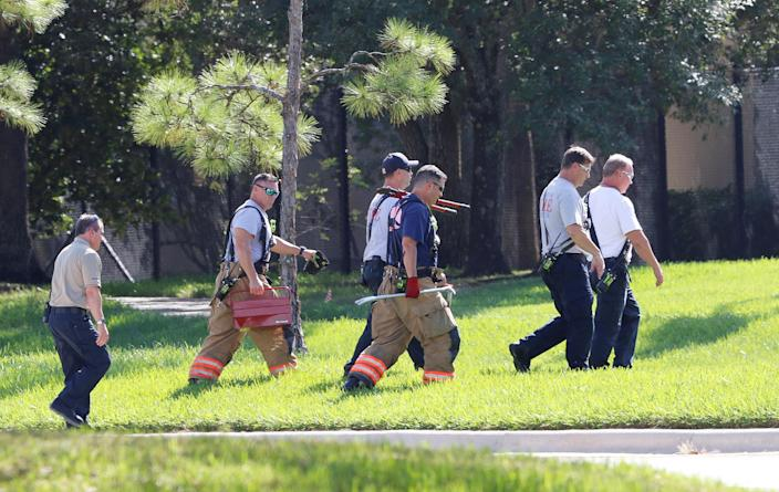 <p>Responders walk towards a building containing the office of U.S. Rep. Debbie Wasserman Schultz as the Broward County Sheriff's Office bomb squad performs a search in Sunrise,, Fla., Oct. 24, 2018 (Photo: Joe Skipper/Reuters) </p>