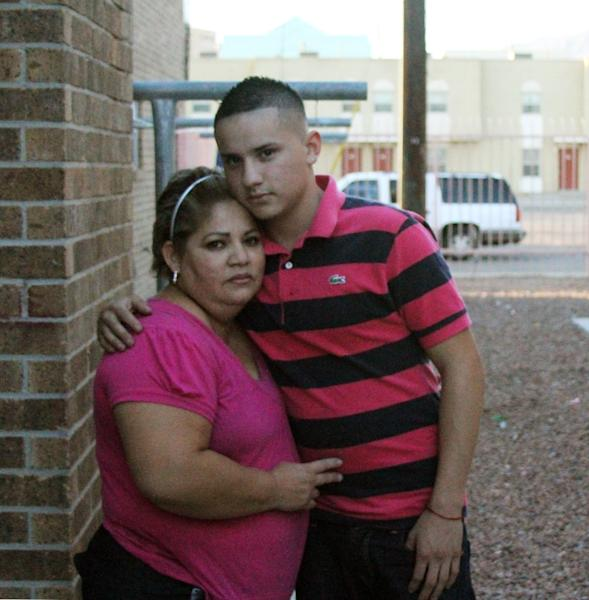 In a Monday, Sept. 10, 2012 photo, former El Paso Independent School District student Roger Avalos hugs his mother Grisel Avalos outside their house, in El Paso, Texas. A cheating scandal in which schools would get rid of underperforming students to artificially inflate their high stakes test scores has rocked the El Paso ISD, landed a former superintendent in jail and prompted the Texas Education Agency to put the district on probation. During his sophomore year, Jose Avalos was urged by a principal to drop out of high school. The next year, his brother was told to do the same after entering the 10th grade. A third Avalos brother shared the same fate in 2009. Administrators at Bowie High School cited excessive tardiness in their efforts to remove the siblings. But now the brothers suspect they were targeted for an entirely different reason: The district was trying to push out hundreds of low-performing sophomores to prevent them from taking accountability tests. (AP Photo/Juan Carlos Llorca)