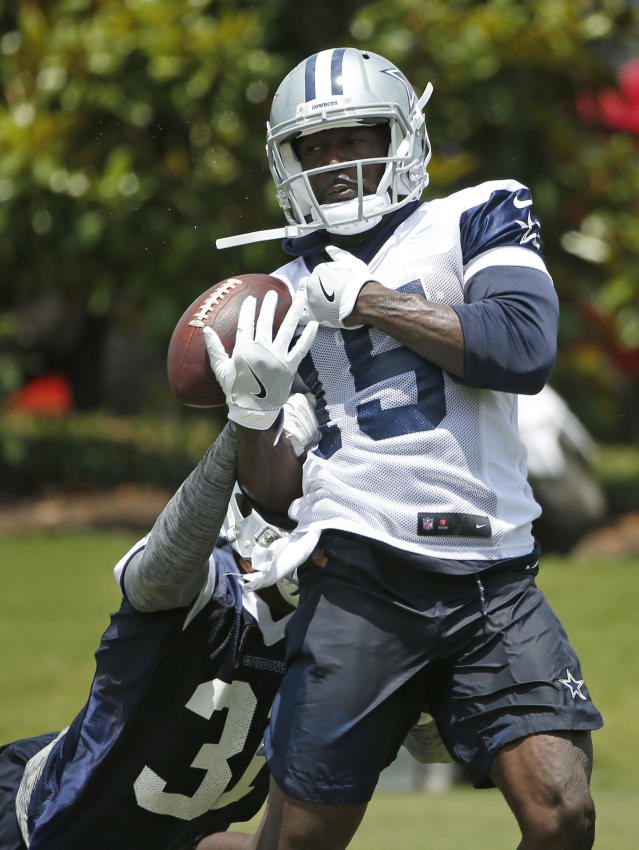 Dallas Cowboys cornerback Byron Jones (31) breaks up a pass intended for wide receiver Deonte Thompson (15) during an organized team activity at its NFL football training facility in Frisco, Texas, Wednesday, May 23, 2018. (AP Photo/Ron Jenkins)