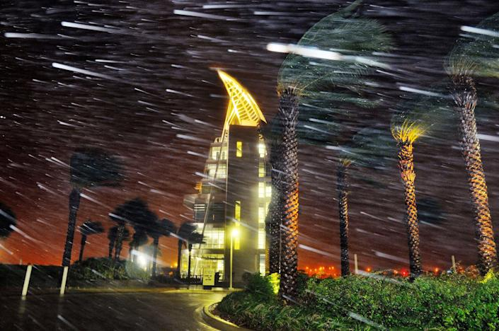 <p>OCT. 7, 2016 — Trees sway from heavy rain and wind during Hurricane Matthew in front of Exploration Tower in Cape Canaveral, Fla. (Craig Rubadoux/Florida Today via AP) </p>