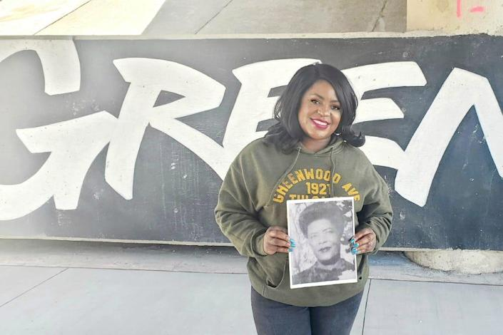 Tiffany Crutcher holding a photo of her great-grandmother.