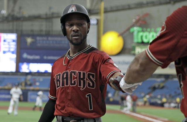 Arizona Diamondbacks' Jarrod Dyson, left, celebrates with Ketel Marte after scoring on a fielder's choice by Adam Jones during the first inning of a baseball game Wednesday, May 8, 2019, in St. Petersburg, Fla. (AP Photo/Chris O'Meara)