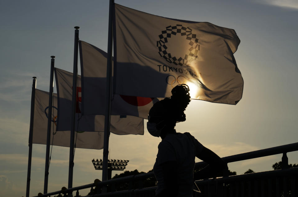 A person walks through the stands at Oi Hockey Stadium ahead of the the 2020 Summer Olympics, Thursday, July 22, 2021, in Tokyo, Japan. (AP Photo/John Locher)