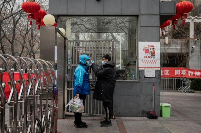The city is normally quiet around the Lunar New Year holiday but news of the rapidly spreading infection has left malls and boulevards exceptionally silent (AFP Photo/NICOLAS ASFOURI)