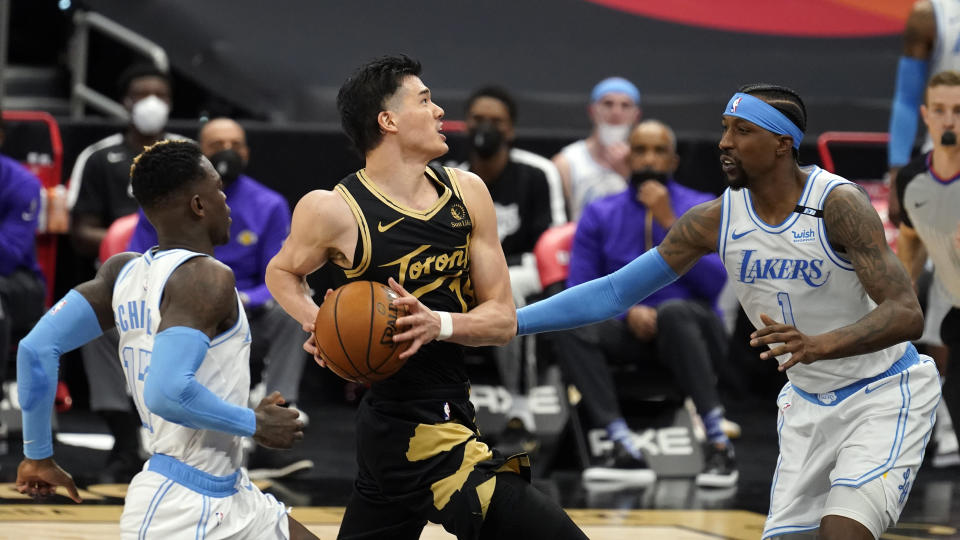 Toronto Raptors forward Yuta Watanabe, of Japan, (18) goes for a shot after getting past Los Angeles Lakers guard Dennis Schroder (17) and guard Kentavious Caldwell-Pope (1) during the second half of an NBA basketball game Tuesday, April 6, 2021, in Tampa, Fla. (AP Photo/Chris O'Meara)