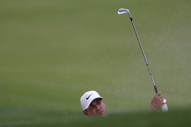 Brooks Koepka hits from a fairway bunker on the 13th hole during third-round play in the Tour Championship golf tournament Sunday, Aug. 25, 2019, at East Lake Golf Club in Atlanta. (AP Photo/John Bazemore)