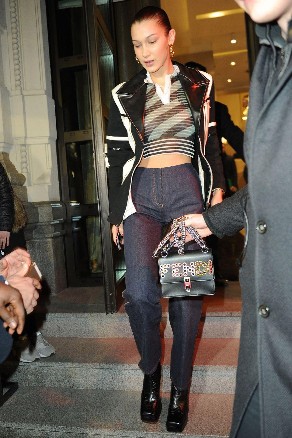 <p>In a Fendi top, jeans, and handbag, a black and white blazer, and square toe boots while out in Milan.</p>