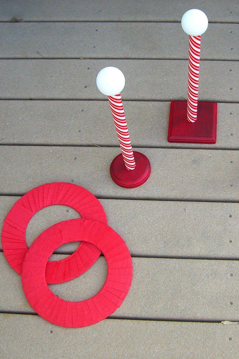 "<p>Dress in red and white, and use some low-budget frisbee rings to toss onto the wooden stands.</p><p><a class=""link rapid-noclick-resp"" href=""https://www.amazon.com/Crystallove-Plastic-Multicolor-Carnival-Backyard/dp/B01EV1C5Z6/?tag=syn-yahoo-20&ascsubtag=%5Bartid%7C2140.g.35058682%5Bsrc%7Cyahoo-us"" rel=""nofollow noopener"" target=""_blank"" data-ylk=""slk:SHOP RING TOSS"">SHOP RING TOSS</a><br></p><p><em><a href=""http://homeconfetti.blogspot.com/2012/12/tutorial-north-pole-game.html"" rel=""nofollow noopener"" target=""_blank"" data-ylk=""slk:Get the tutorial at Home Confetti »"" class=""link rapid-noclick-resp"">Get the tutorial at Home Confetti »</a></em><br></p>"