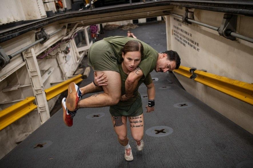 Marines have to be able to carry one another if necessary. USMC Cpl Gabrielle Green hefts a fellow marine as they ready for deployment on a Navy ship at Camp Lejeune, North Carolina. Of the 38,000 recruits who enter the corps each year, about 3,500 are women. (National Geographic/Lynsey Addario)