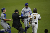 Los Angeles Dodgers starting pitcher Dennis Santana, center, has words with San Diego Padres' Jorge Mateo (3) after Mateo was hit by a pitch during the tenth inning of a baseball game Friday, April 16, 2021, in San Diego. (AP Photo/Gregory Bull)