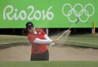 <p>Inbee Park of South Korea, hits from the bunker on the 18th hole during the final round of the women's golf event at the 2016 Summer Olympics in Rio de Janeiro, Brazil, Saturday, Aug. 20, 2016. Park won the gold medal. (AP Photo/Chris Carlson) </p>