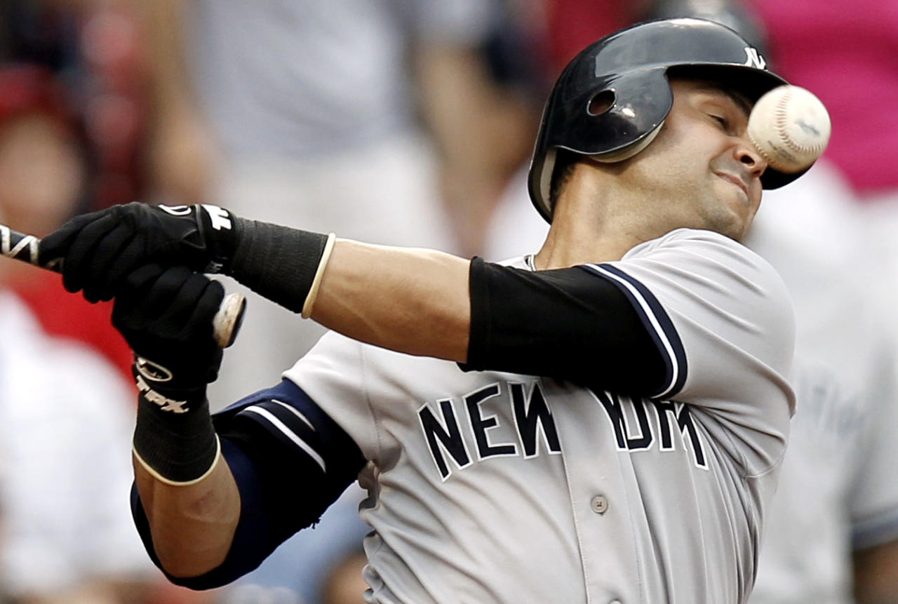 BOSTON, MA - JULY 7:  Nick Swisher #33 of the New York Yankees fouls off a ball during the eighth inning of game one of a doubleheader against the Boston Red Sox at Fenway Park on July 7, 2012 in Boston, Massachusetts.  (Photo by Winslow Townson/Getty Images)