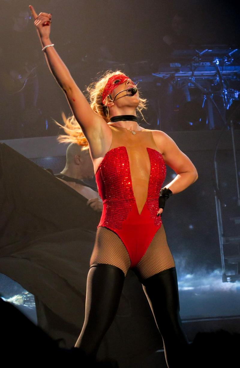 Britney shows off her toned-figure in a racy red corset and fish-nets. Source: Splash