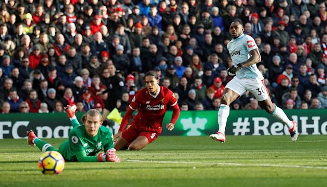 """Soccer Football - Premier League - Liverpool vs West Ham United - Anfield, Liverpool, Britain - February 24, 2018 West Ham United's Michail Antonio scores their first goal as Liverpool's Loris Karius looks on Action Images via Reuters/Carl Recine EDITORIAL USE ONLY. No use with unauthorized audio, video, data, fixture lists, club/league logos or """"live"""" services. Online in-match use limited to 75 images, no video emulation. No use in betting, games or single club/league/player publications. Please contact your account representative for further details."""