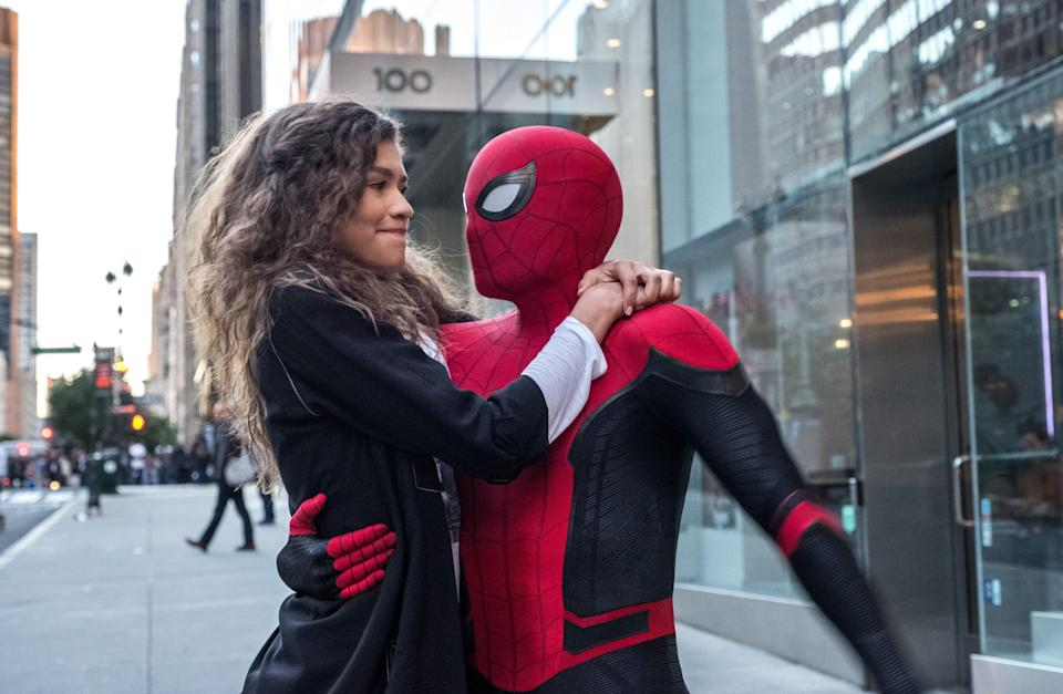 """MJ (Zendaya) catches a ride from Spider-Man (Tom Holland) in """"Spider-Man: Far From Home."""""""