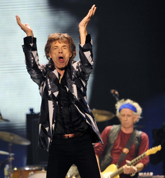 "Mick Jagger, left, and Keith Richards of the Rolling Stones perform on the kick-off of the band's ""50 and Counting"" tour at the Staples Center on Friday, May 3, 2013 in Los Angeles. (Photo by Chris Pizzello/Invision/AP)"