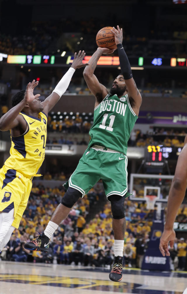 Boston Celtics guard Kyrie Irving (11) shoots over Indiana Pacers guard Darren Collison (2) during the first half of Game 4 of an NBA basketball first-round playoff series in Indianapolis, Sunday, April 21, 2019. (AP Photo/Michael Conroy)