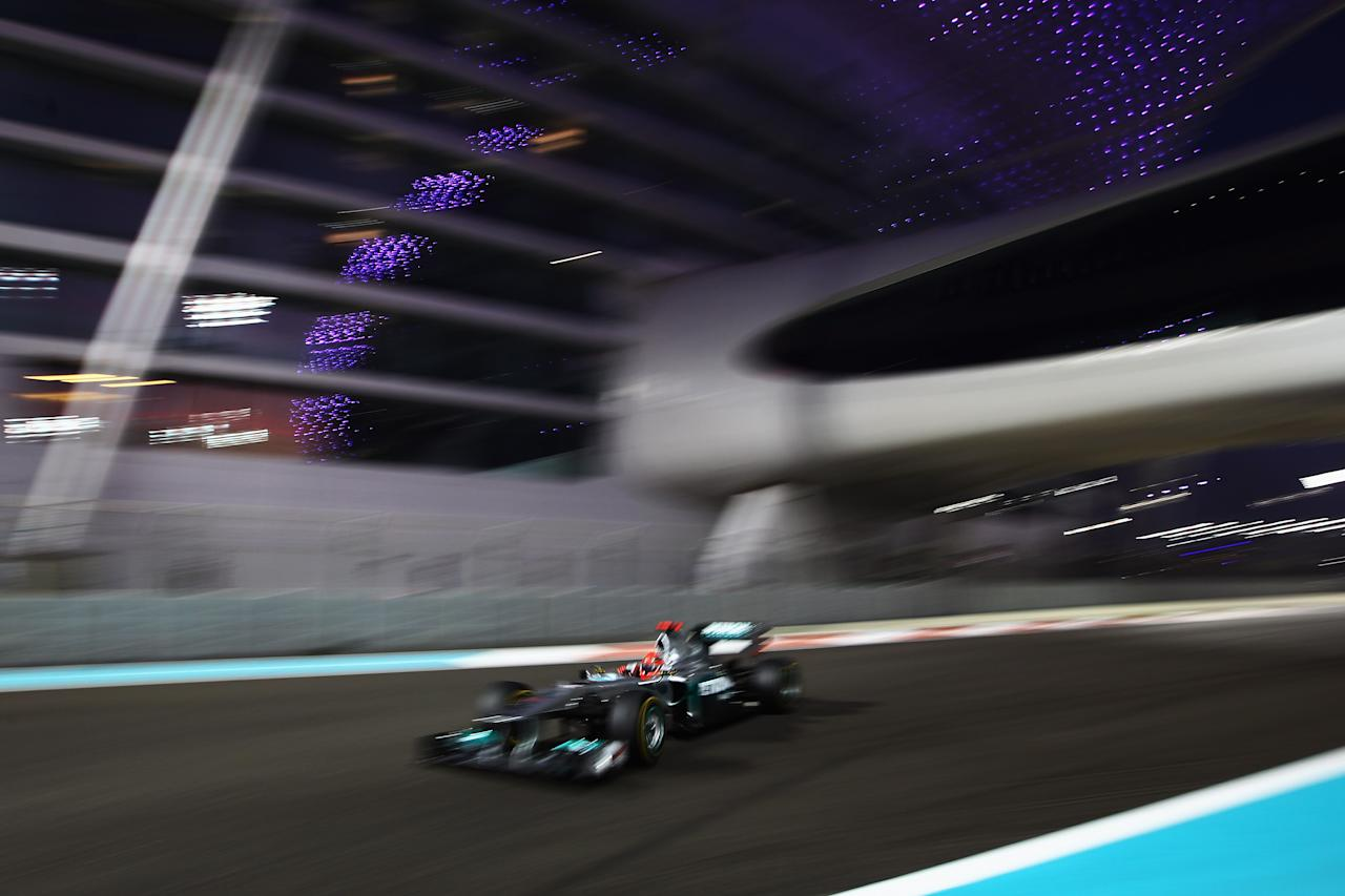 ABU DHABI, UNITED ARAB EMIRATES - NOVEMBER 13:  Michael Schumacher of Germany and Mercedes GP drives during the Abu Dhabi Formula One Grand Prix at the Yas Marina Circuit on November 13, 2011 in Abu Dhabi, United Arab Emirates.  (Photo by Clive Mason/Getty Images)