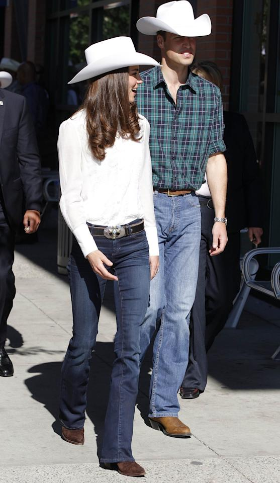 <p>The Duchess looked the part in a white stetson, jeans and a shirt as they touched down in Calgary. <br /><em>[Photo: PA]</em> </p>
