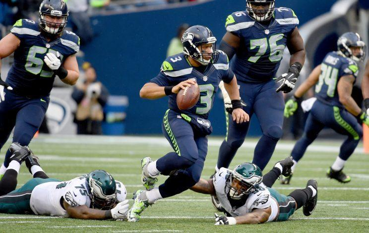 Russell Wilson battled through injury and poor performance around him to get the Seahawks to the playoffs once again. (Getty)
