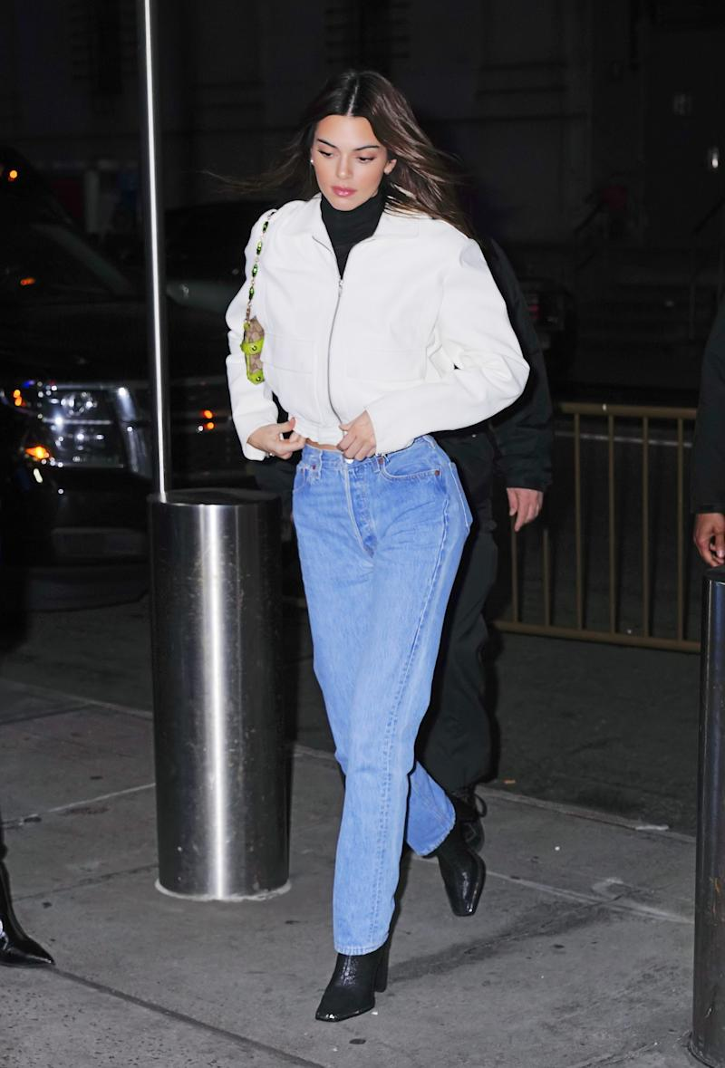 Kendall Jenner's jeans and booties look has a vintage touch.