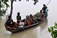 DARRANG,INDIA-JULY 21,2020 :Flood affected villagers are transported on a boat towards a safer place at Puthimari village in Darrang District of Assam ,India - PHOTOGRAPH BY Anuwar Ali Hazarika / Barcroft Studios / Future Publishing (Photo credit should read Anuwar Ali Hazarika/Barcroft Media via Getty Images)