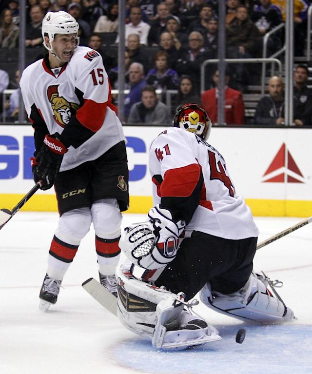 Ottawa Senators center Zack Smith (15) yells out to Senators goalie Craig Anderson (41) that the puck is behind during the second period of their NHL hockey game against the Los Angeles Kings, Wednesday, Oct. 9, 2013, in Los Angeles. (AP Photo/Alex Gallardo)