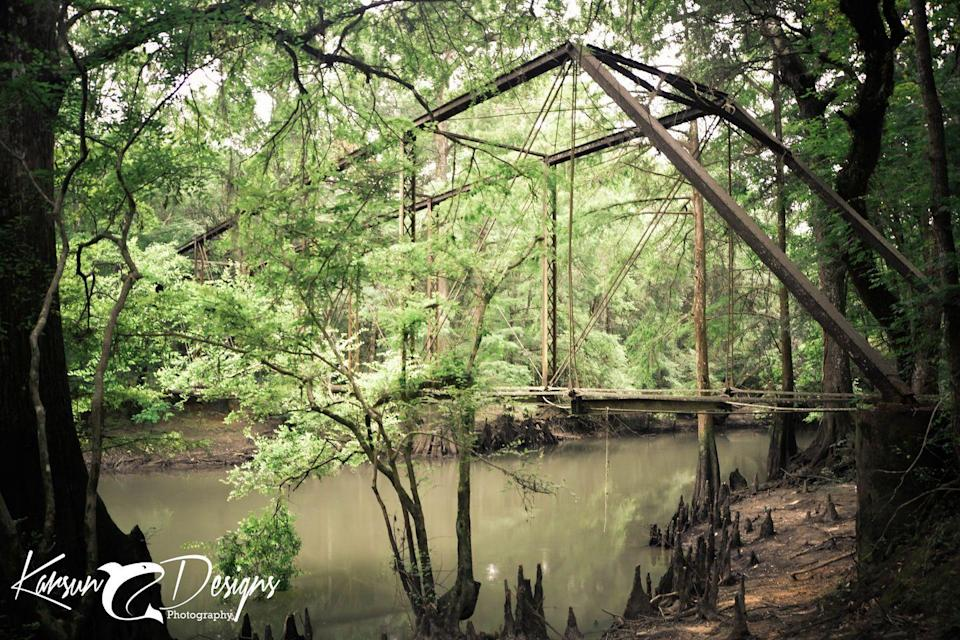"""<p>For a taste of true haunting love, travel over this spooky bridge in <a href=""""https://go.redirectingat.com?id=74968X1596630&url=https%3A%2F%2Fwww.tripadvisor.com%2FTourism-g34422-Marianna_Florida-Vacations.html&sref=https%3A%2F%2Fwww.countryliving.com%2Flife%2Fg3793%2Fscary-ghost-stories%2F"""" rel=""""nofollow noopener"""" target=""""_blank"""" data-ylk=""""slk:Marianna, Florida,"""" class=""""link rapid-noclick-resp"""">Marianna, Florida,</a> which has several ghost legends surrounding the structure, according to its <a href=""""https://bellamybridge.org/"""" rel=""""nofollow noopener"""" target=""""_blank"""" data-ylk=""""slk:official website"""" class=""""link rapid-noclick-resp"""">official website</a>. In the 1830s, Elizabeth Jane Croom Bellamy married local politician Dr. Samuel C. Bellamy. On their wedding night, her dress accidentally caught on fire, which covered the young bride in horrible burns. She initially survived, but eventually passed away. Elizabeth was buried along the banks of the Chipola River, and it was said that her love for her husband was so strong, she couldn't rest. The deceased newlywed, dressed in white, can allegedly be seen wandering the banks from the vantage point of the bridge (which was built after she died). It's said that she appears on fire either walking through the swamps or diving straight into the river, as if to douse the flames, or somberly walking along the side of the river.<br></p>"""
