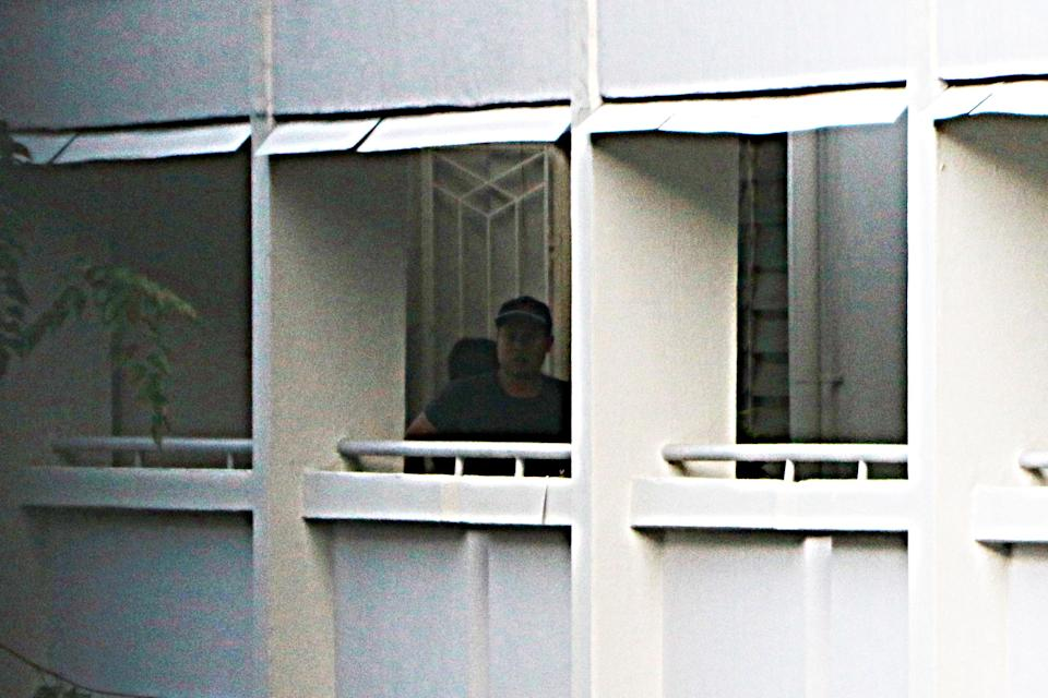A man and woman seen leaving the Hougang flat on 5 October. They parted ways below the block. (PHOTO: Dhany Osman / Yahoo News Singapore)