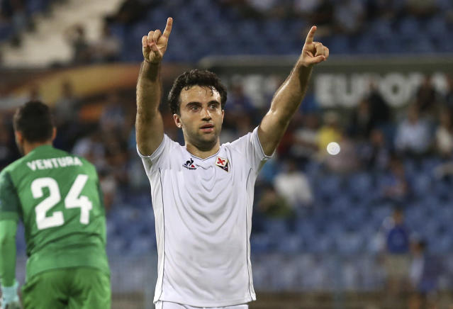 FILE - In this Oct. 1, 2015, file photo, Fiorentina's Giuseppe Rossi celebrates after scoring his side's fourth goal during a Europa League group I soccer match against Belenenses at the Restelo stadium in Lisbon. Rossi has signed with Major League Soccer's Real Salt Lake, 21 months after his last competitive match. The 33-year-old from Clifton, N.J., had spent his entire professional career in Europe after moving when he was 12 to join Parma's youth academy, but he has been derailed by five major knee injuries. (AP Photo/Armando Franca, File)